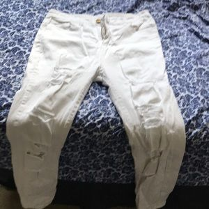 White ripped pants